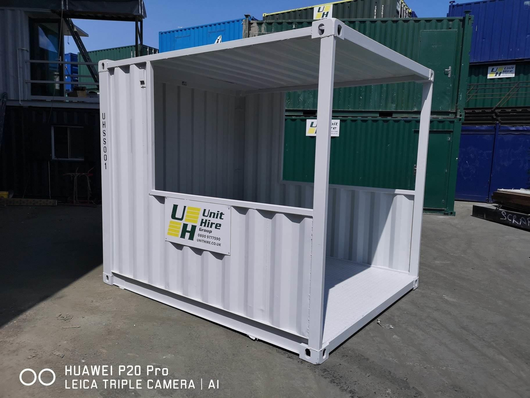 Grey Unit Hire smoking shelter amongst many shipping containers