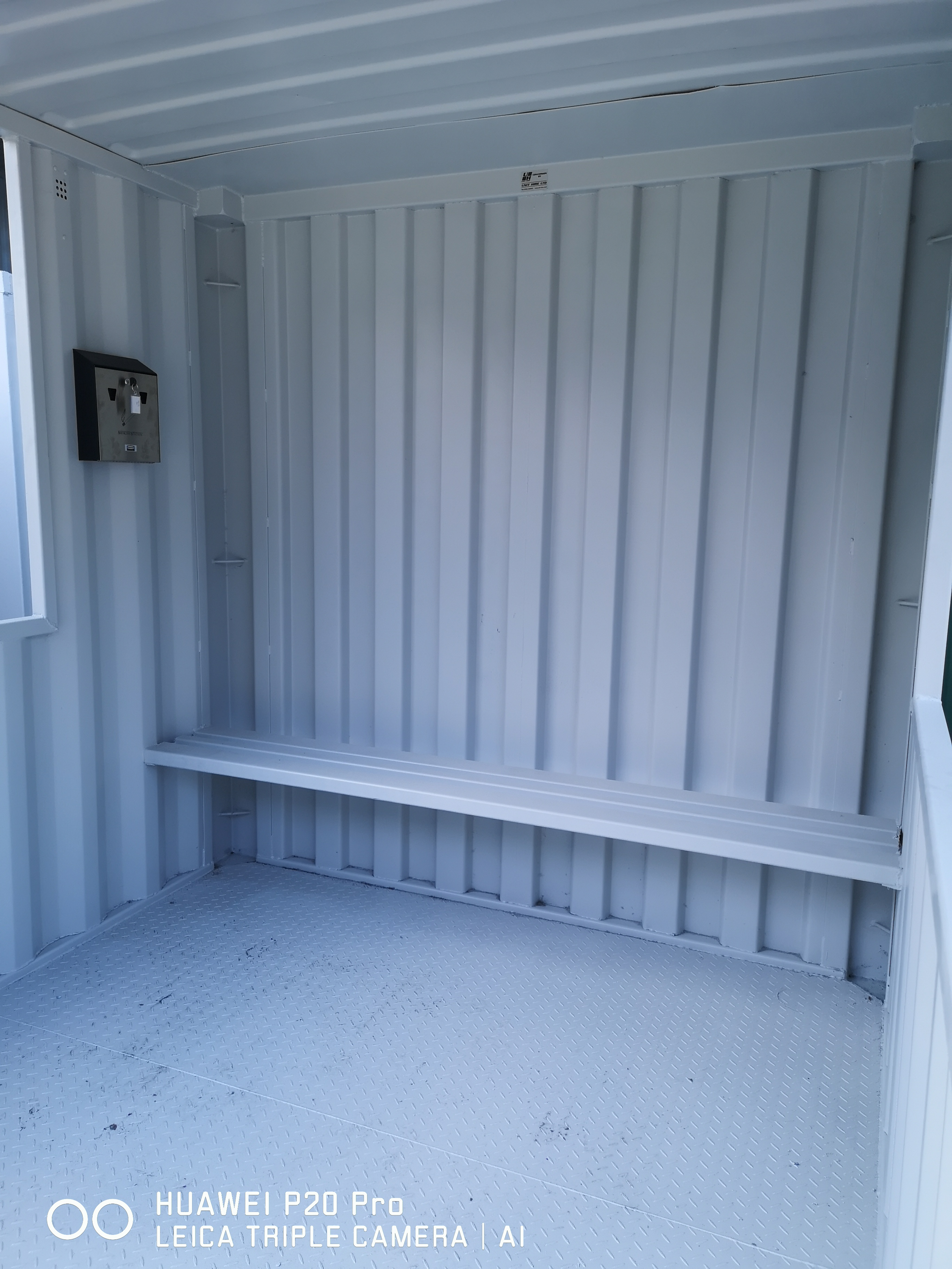 inside of a converted shipping container smoking shelter