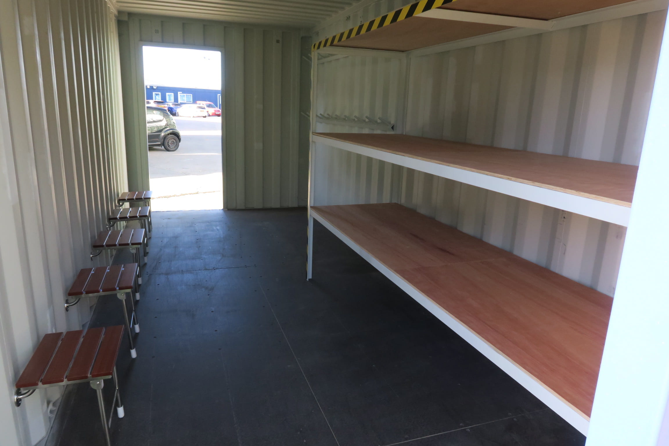 Shipping container changing room shelves